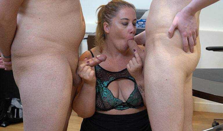 Big ass secretary blows two dicks and gets a double penetration