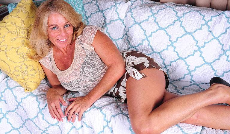 Hot American housewife playing with her shaved pussy