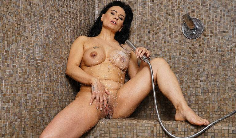 Sexy Milf gets turned on in the shower and masturbates