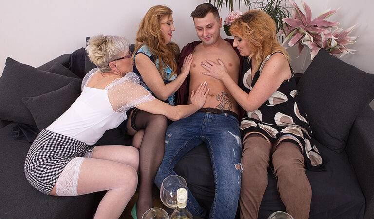 Three horny mature ladies share their toyboy's cock